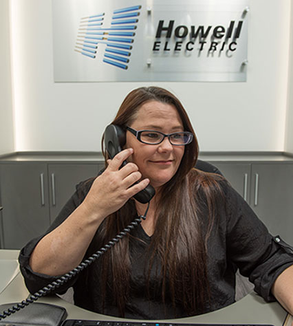 Woman answering a telephone